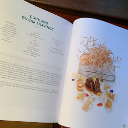 book pages from Arzak + Arzak showing recipe and picture of fancy food