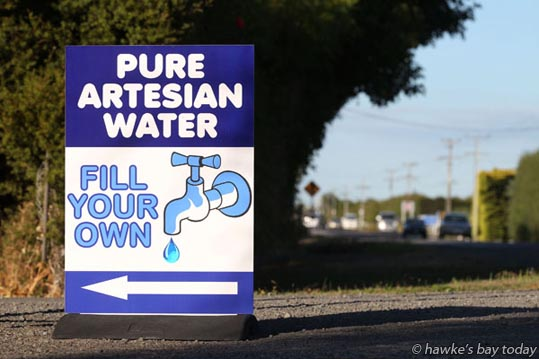 Pure artesian water, fill your own - sign outside an orchard at 1089 Maraekakaho Rd, Hastings. photograph