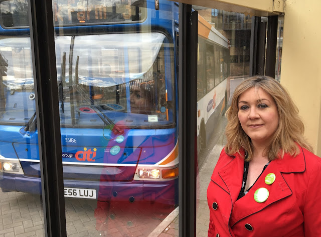 Julie standing by a Stagecoach bus