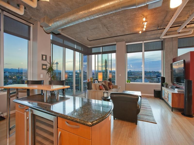 Living room in Denver penthouse with an incredible views as seen from the kitchen