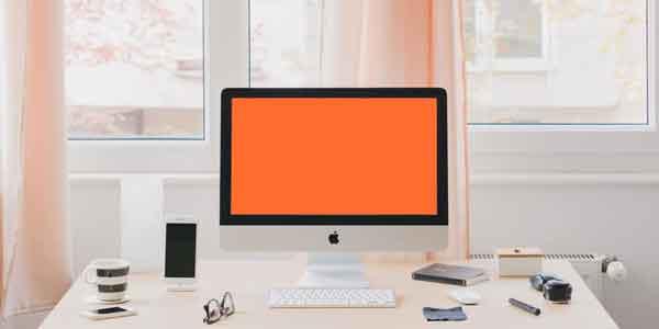 iMac on Desktop Mockup Template PSD