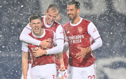 Arsenal players celebrate with Kieran Tierney after his brilliant goal away at West Brom