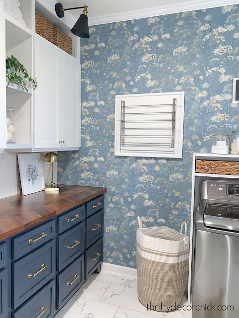 Blue floral wallpaper mud room cabinets