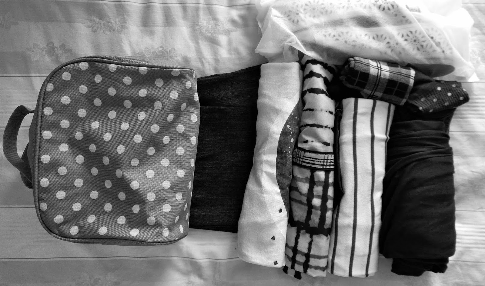 Rolled up clothing for packing a suitcase efficiently | Funky Jungle - Mindful fashion, life & quirky personal style