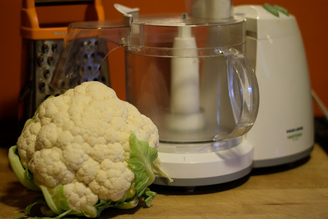 The ingredients and tools needed to make the cauliflower rice.