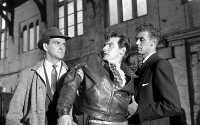 Stanley Baker as Inspector Martineau arresting a suspect
