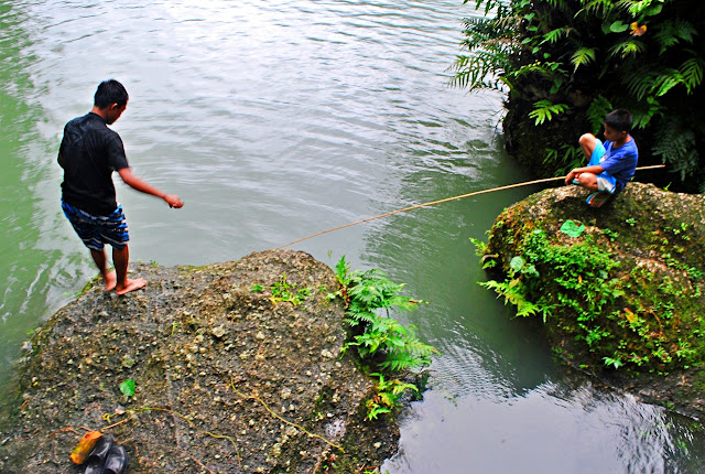 Kids fishing in lake balanan