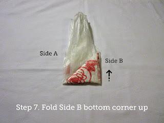 Step 7. Fold Side B bottom corner up.