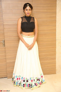 Roshni Prakash in a Sleeveless Crop Top and Long Cream Ethnic Skirt 049.JPG