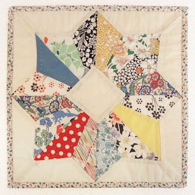 vintage quilt block, hand quilted and bound by Robin Atkins