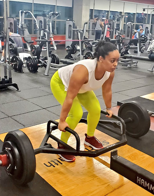 Woman Lifting Heavy Weights in a Fabletics Outfit and Sneakers