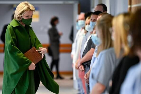 Queen Mathilde wore a green wool cashmere cape coat from Natan, and green checked viscose canvas midi dress from Belgian fashion house Natan