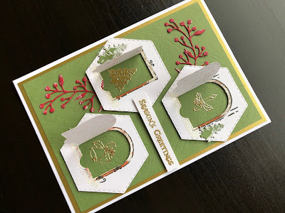 Hand made Christmas card with die cut fairy doors opened and heat embossed snow