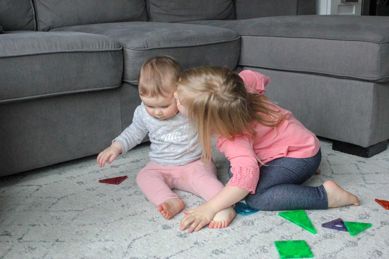 kids playing with magnetic tiles