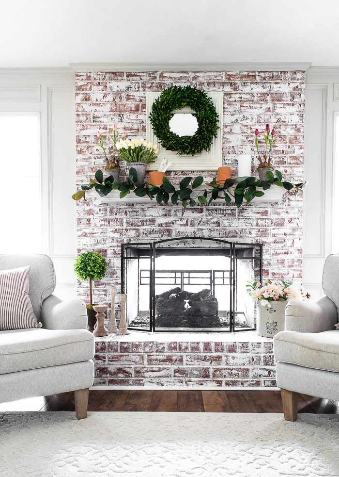 painted brick fireplace and mantel decorated for Spring
