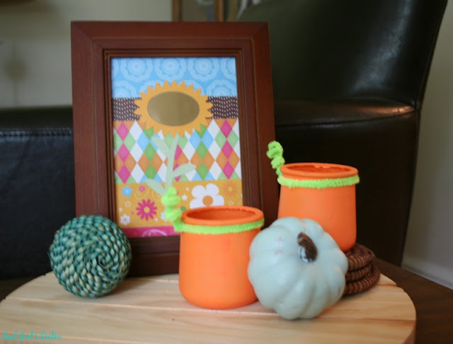 I am partnering with Curly Crafty Mom and Mom Home Guide to bring you 3 ways to re-purpose these glass jars! I decided to make my glass jars into pumpkin votive holders.