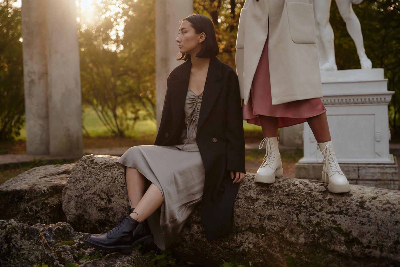 two women in the park wearing fall oufits