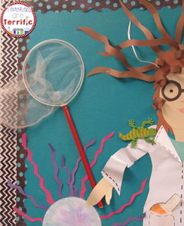 Adding the butterfly net was the perfect touch for this re-purposed bulletin board! Makes it 3-D, too!
