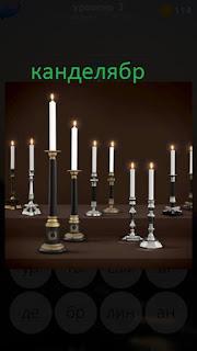 389 фото несколько канделябров со свечами на столе 3 уровень