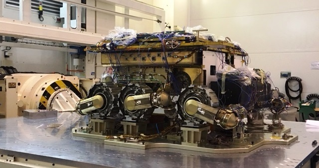 The structural model of the ExoMars rover, provided by ESA as part of the ESA/Roscosmos ExoMars mission, with three of its six wheels visible. Credit: Airbus Defence and Space UK