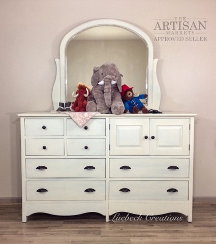 white dresser with rubbed bronze hardware
