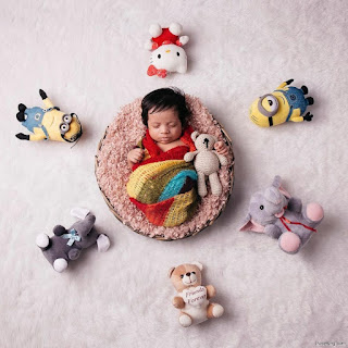 Baby Photoshoot Pose With Toys