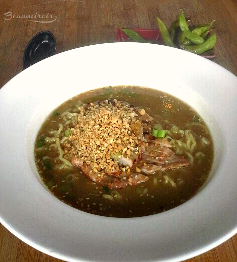 Noodle Theory's Grilled Niman Ranch Spicy Pork Loin Ramen  in a Peanut Lime Cilantro Broth