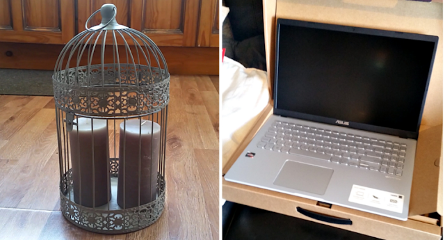 A decorative bird cage with 2 candles in and a new laptop.
