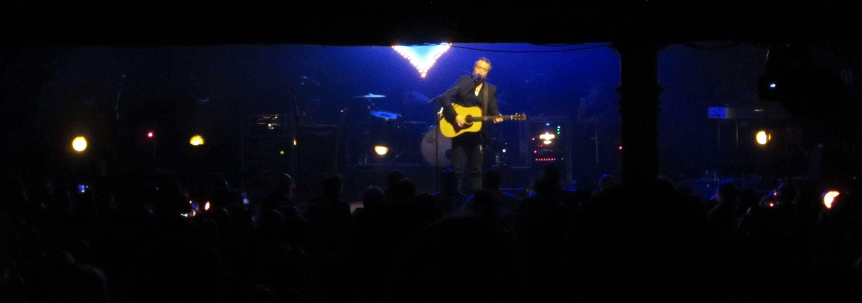 Jason Isbell performing at the Ryman Auditorium