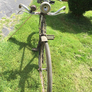 Old Royal Enfield bike with big bicycle bell.