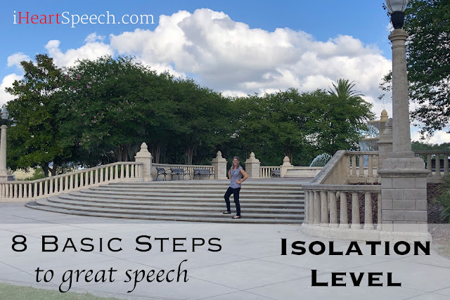 Speech Therapist stands on steps to demonstrate how speech sounds develop