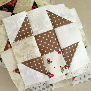 Churn Dash quilt block: QuiltBee
