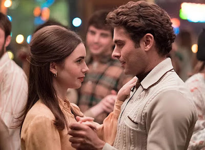 Movie still for Netflix's Extremely Wicked, Shockingly Evil and Vile (2019) where Ted Bundy (Zac Efron) and Liz Kendall (Lily Collins) dance together in a bar