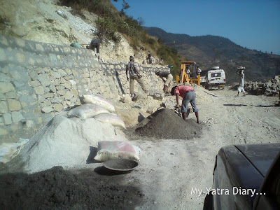 Construction works going on, on damaged and landslide roads in the Garhwal Himalayas during the Char Dham Yatra