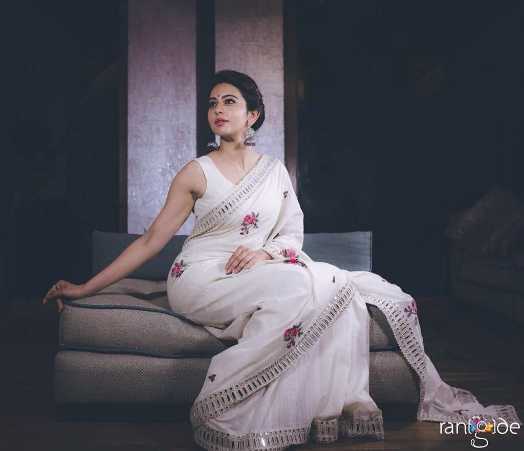 South Indian Actress Rakul Preet Singh Hot Photo shoot In Sleeveless White Saree