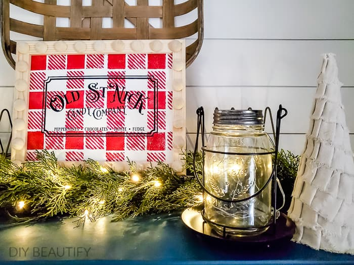Christmas vignette with buffalo check sign