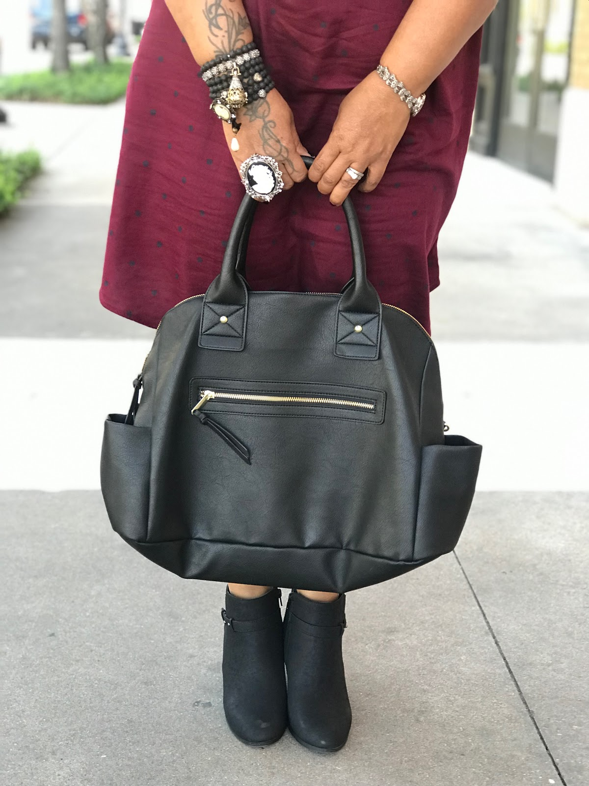 Image: Tangie bell sharing her outfit and handbags she wore to see the intruder movie