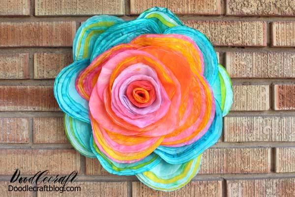 Stapled layers of bright colored coffee filters made into a fluffy layered rose.