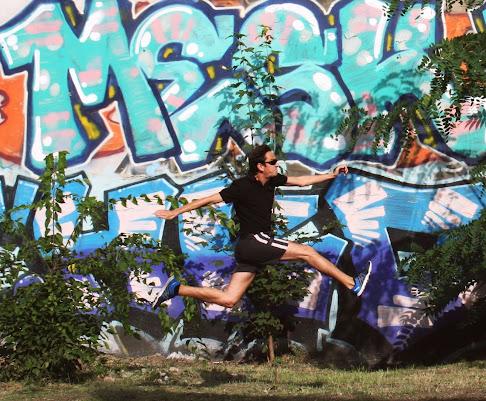 Runner with street art in Berlin
