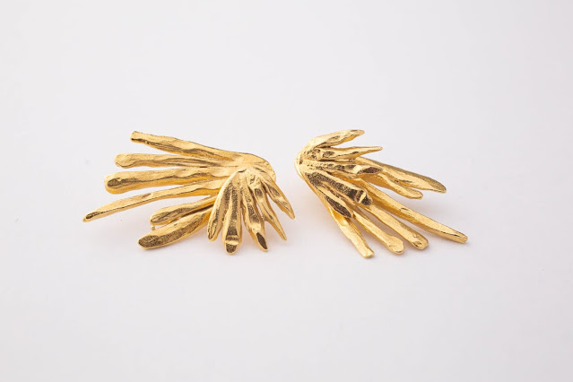 Handcrafted gold earrings from Supply Chain Seattle
