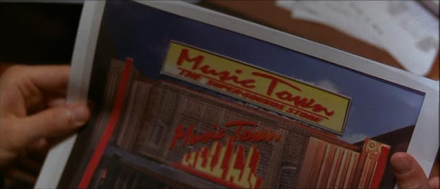 Music Town is a cross between Tower Records and Musicland, two stores that have gone the way of the pager.