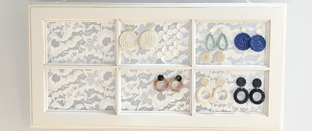 lace window with earrings