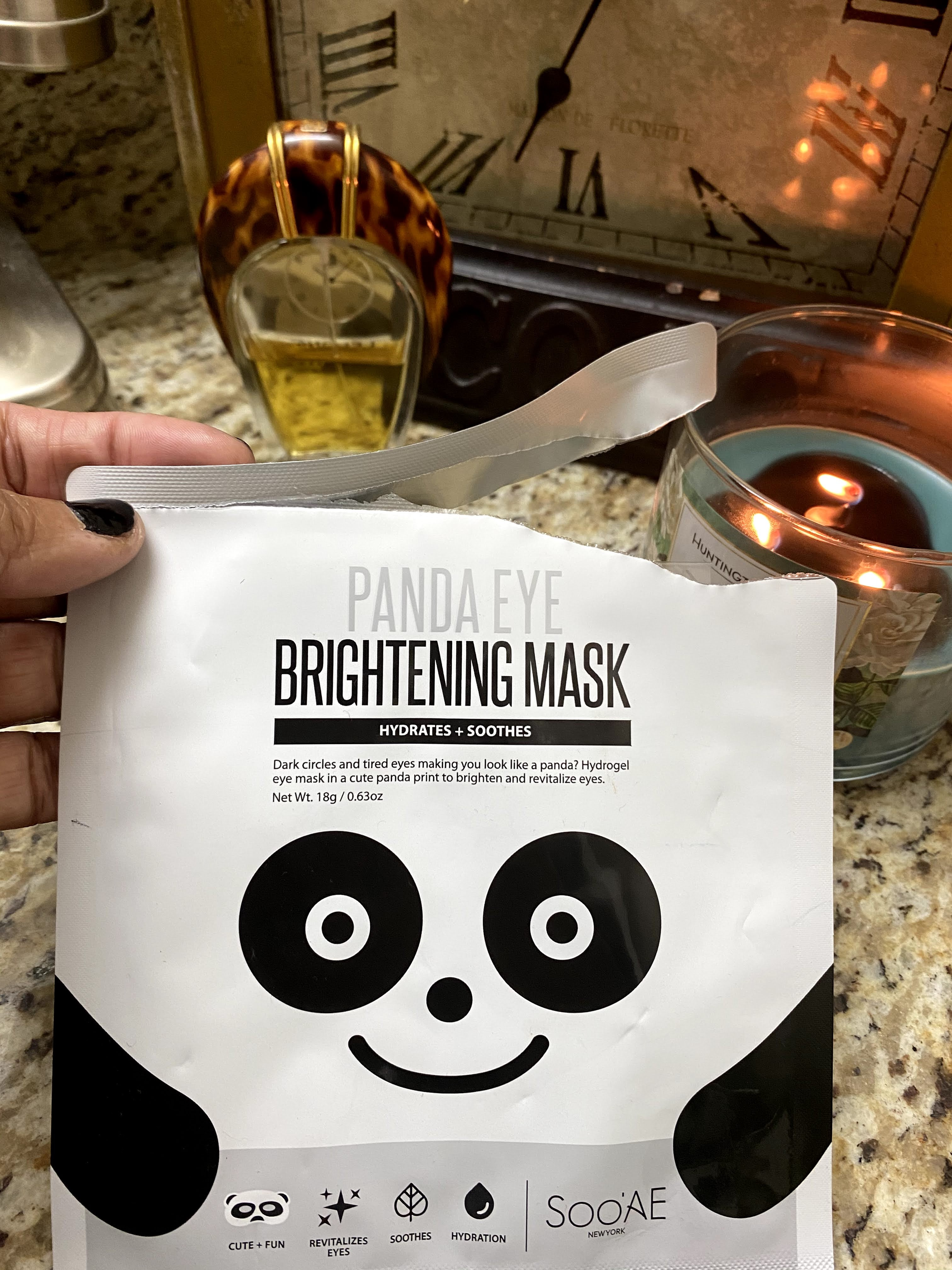 Woman showing off her new panda eye brightening face mask