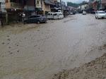 Sungai Meluap Akibat Hujan Deras, Parapat Dilanda Banjir Lumpur dan Batu