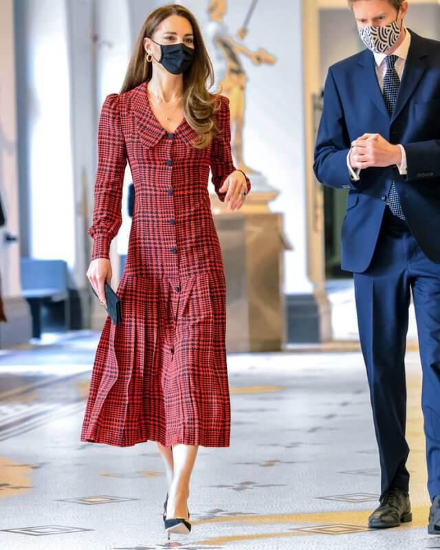 Kate Middleton wore a houndstooth silk midi dress from Alessandra Rich, and earrings from Other Stories. Jennifer Chamandi