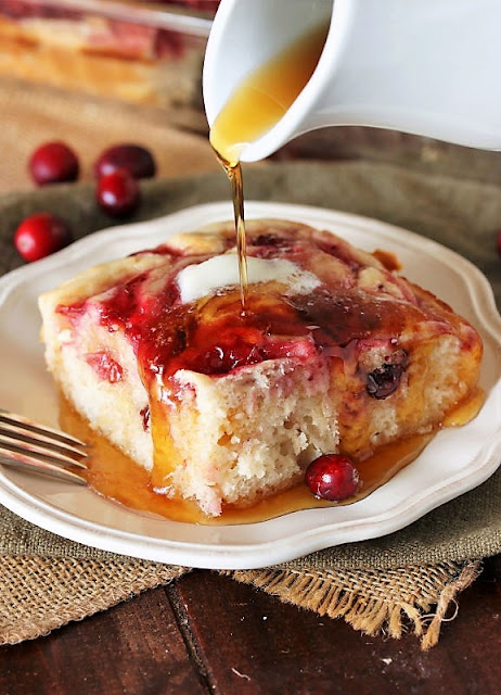 Pouring Maple Syrup on Cranberry Baked Buttermilk Pancakes Image