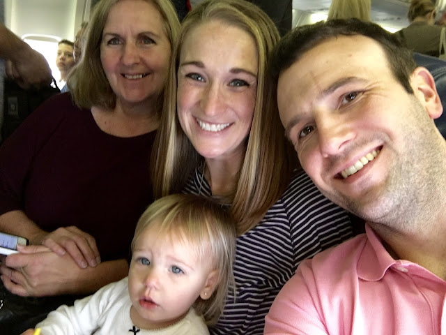 family flying with a lap toddler