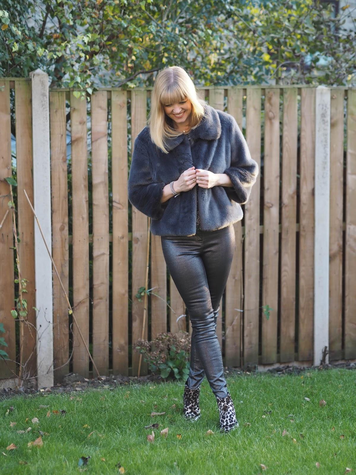 Gunmetal sequin top, silver metallic skinny jeans, snow leopard print boots, over 40