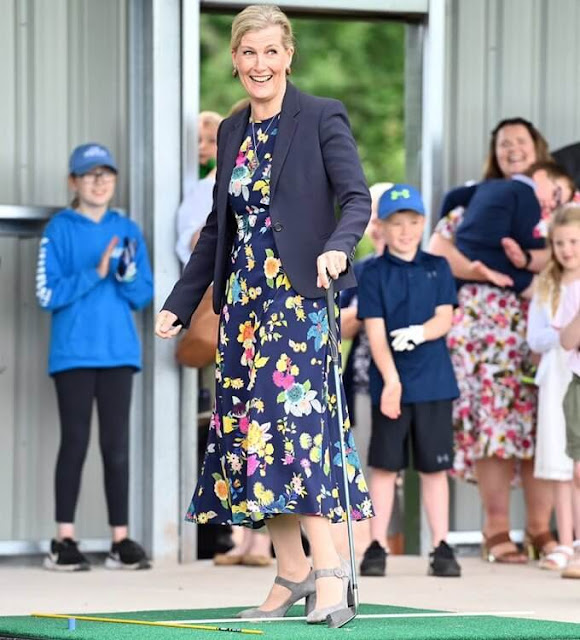 The Countess of Wessex wore a new floral stretch silk crepe midi dress from Etro. The Countess carried Sophie Habsburg clutch