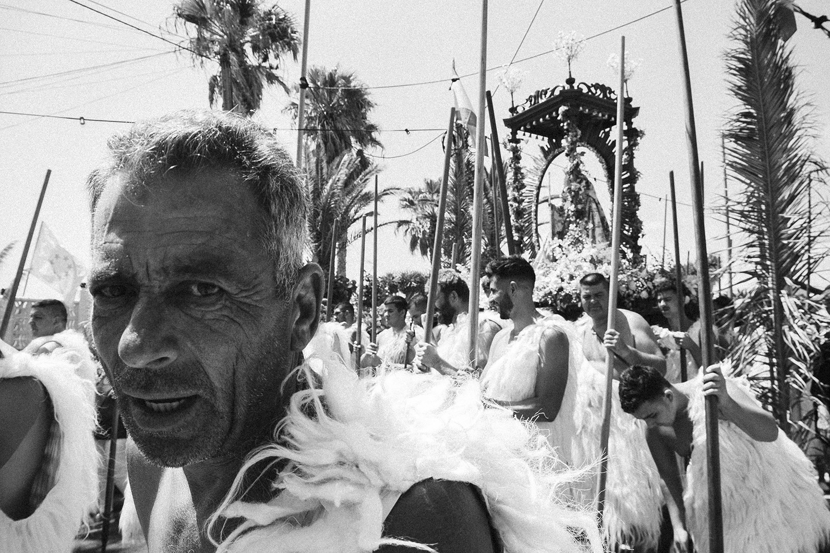 Romeria, Guimar - Socorro; Guanche stares carrying The Virgen
